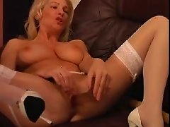 MILF masturbating in her white garter belt and stockings