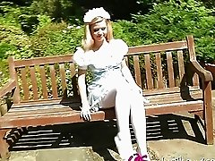 Naughty blonde in maid uniform strips outdoor and has fun