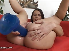 Teen fucking her ass with two big dildos