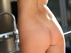 Teen wow model teasing in a kitchen