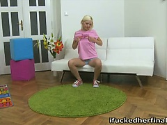 Sexy blonde Daryna sits lonely on her chair waiting for her