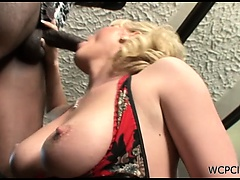 Sexy blonde babe sucks and gets a big black cock