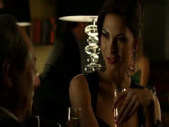 Moran Atias keeping her low-cut red lingerie top on as a