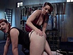 Redhead slut tied up and electrified by mistress