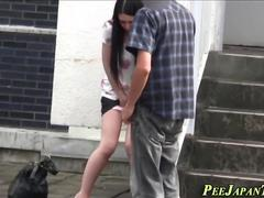 Asian in heels pissing
