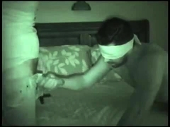 Blindfolded guy working his lips and hands on a huge dick