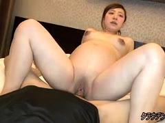 Pregnant Japanese slut gets served a meat shaft on the bed