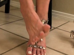 Dominant brunette with sexy long legs teases with her feet