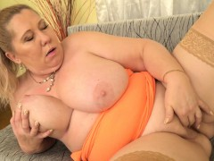 Euro gilf Dita works her big breasts and mature pussy