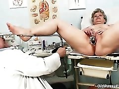 Speculum and dildo fuck a mature in office