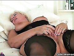 Sexy black lingerie on masturbating mature blonde