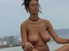 Busty Woman Meditating about the Seaside
