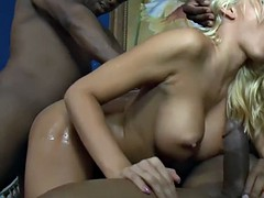 busty blonde woman gets anal fucked by huge black cocks