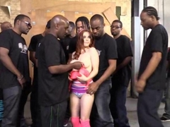 Busty Penny Pax sucks many black cocks for bukkake