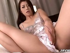Maki Hojo sticks fingers and toys into her hairy muff