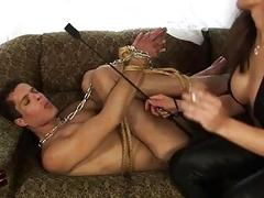 Submissive slaveboy dominated by his mistress shemale
