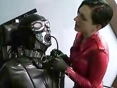 Femdom mistress cock teases a slave in rubber BDSM porn