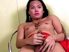 Asian t-girl dances for a bit before masturbating