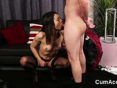 Flirty centerfold gets cumshot on her face eating all the se