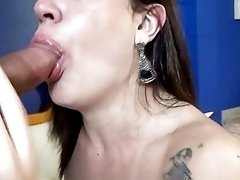 Emotional brunette enjoys having a big dick between her tits