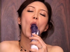 Insatiable Japanese housewife fucks a dildo and a hard cock