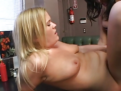 Ebony hottie fucks another chick with a strap-on